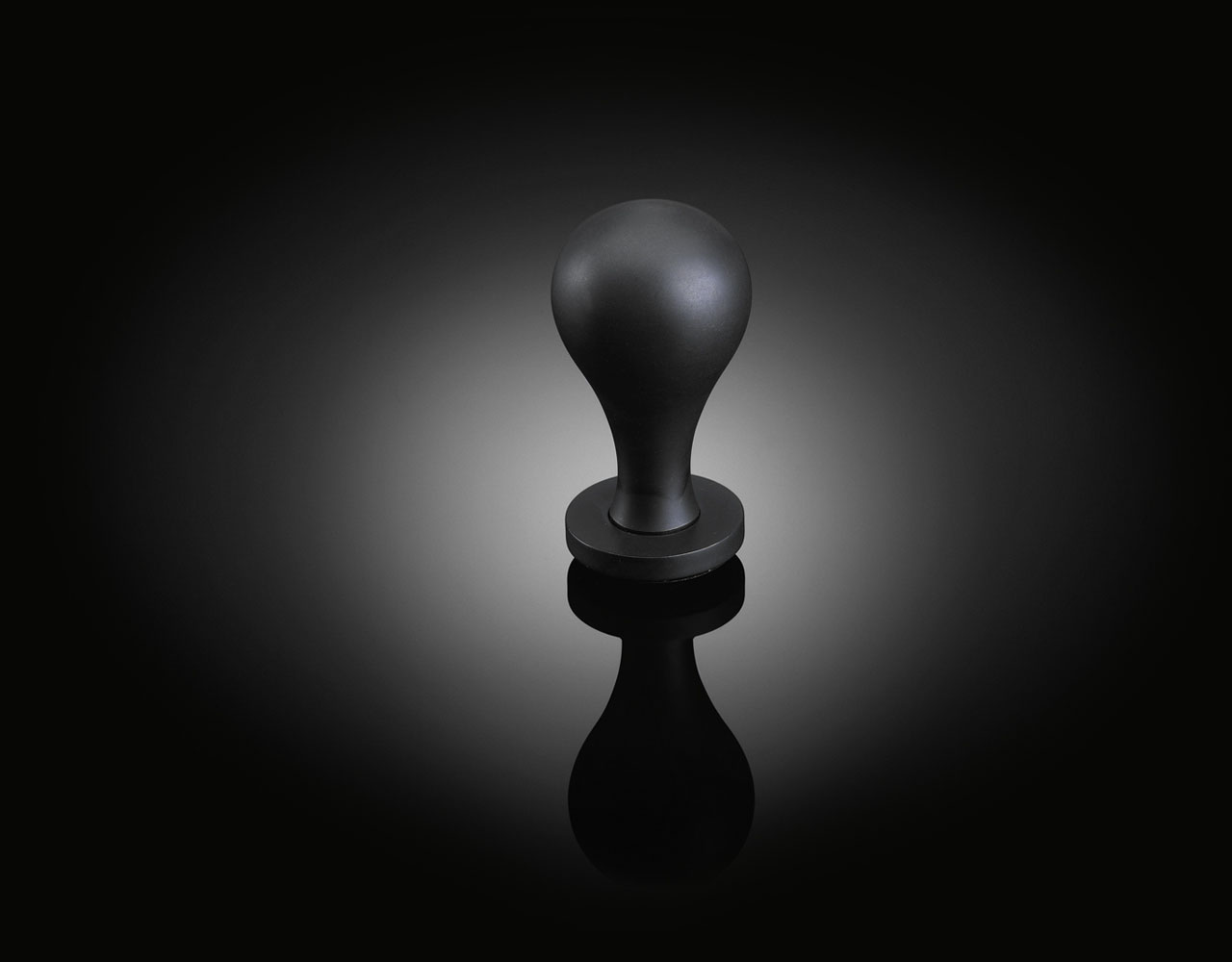 6a Architects designed bespoke door knob in dark bronze finish available at izé