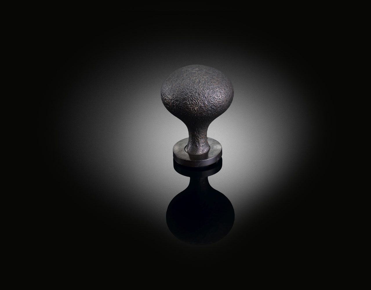 rough cast custom mushroom door knob in dark bronze designed by 6a Architects supplied by izé 6AK05
