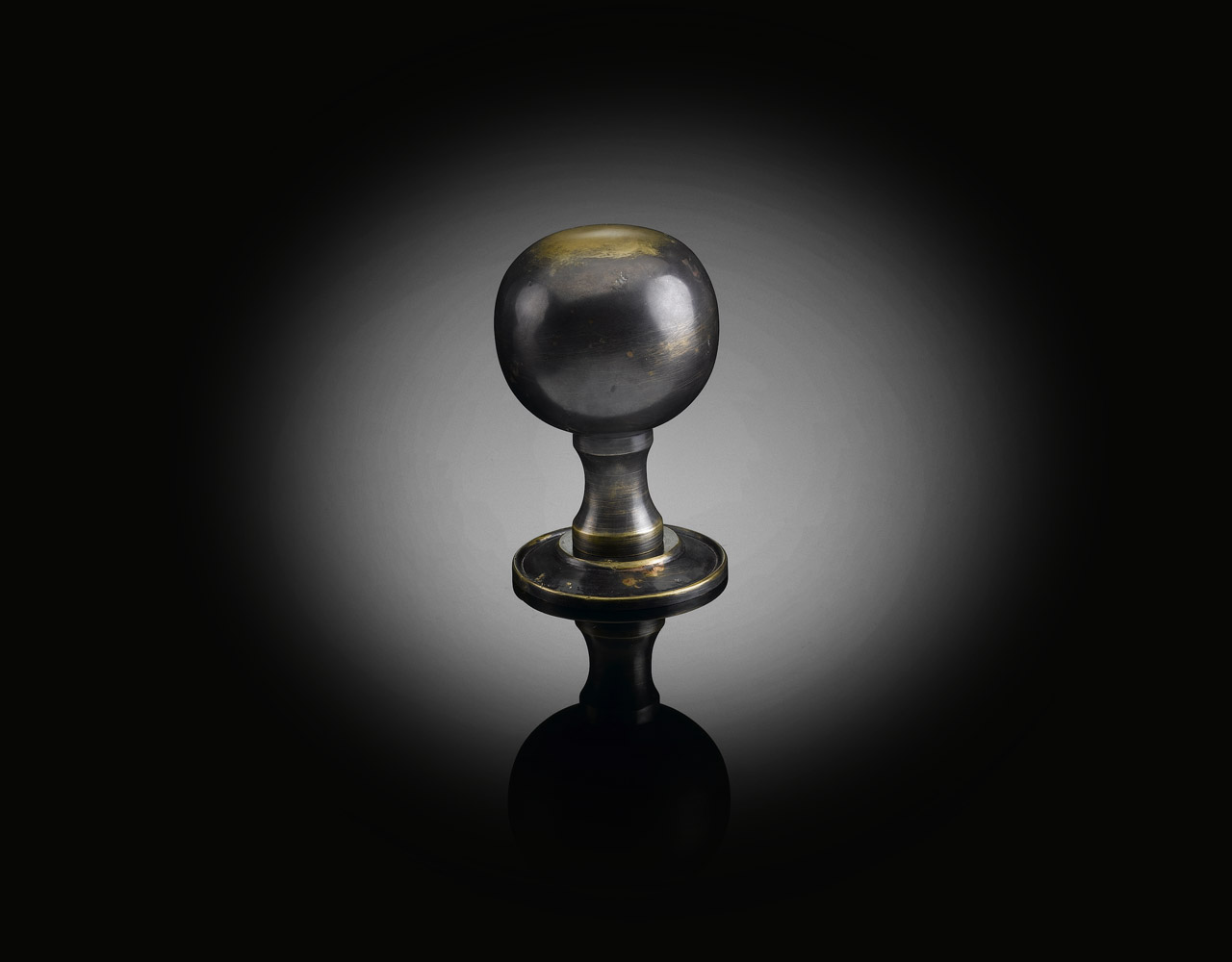 Custom door knob designed by izé in antique finish EHK03