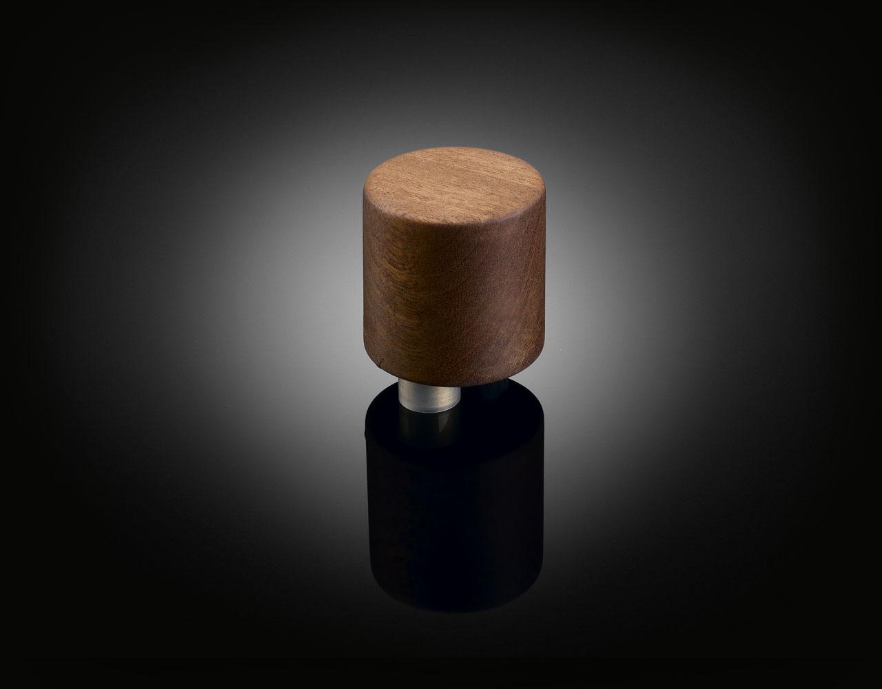 Bespoke walnut door knob designed by Terrence Woodgate supplied by izé