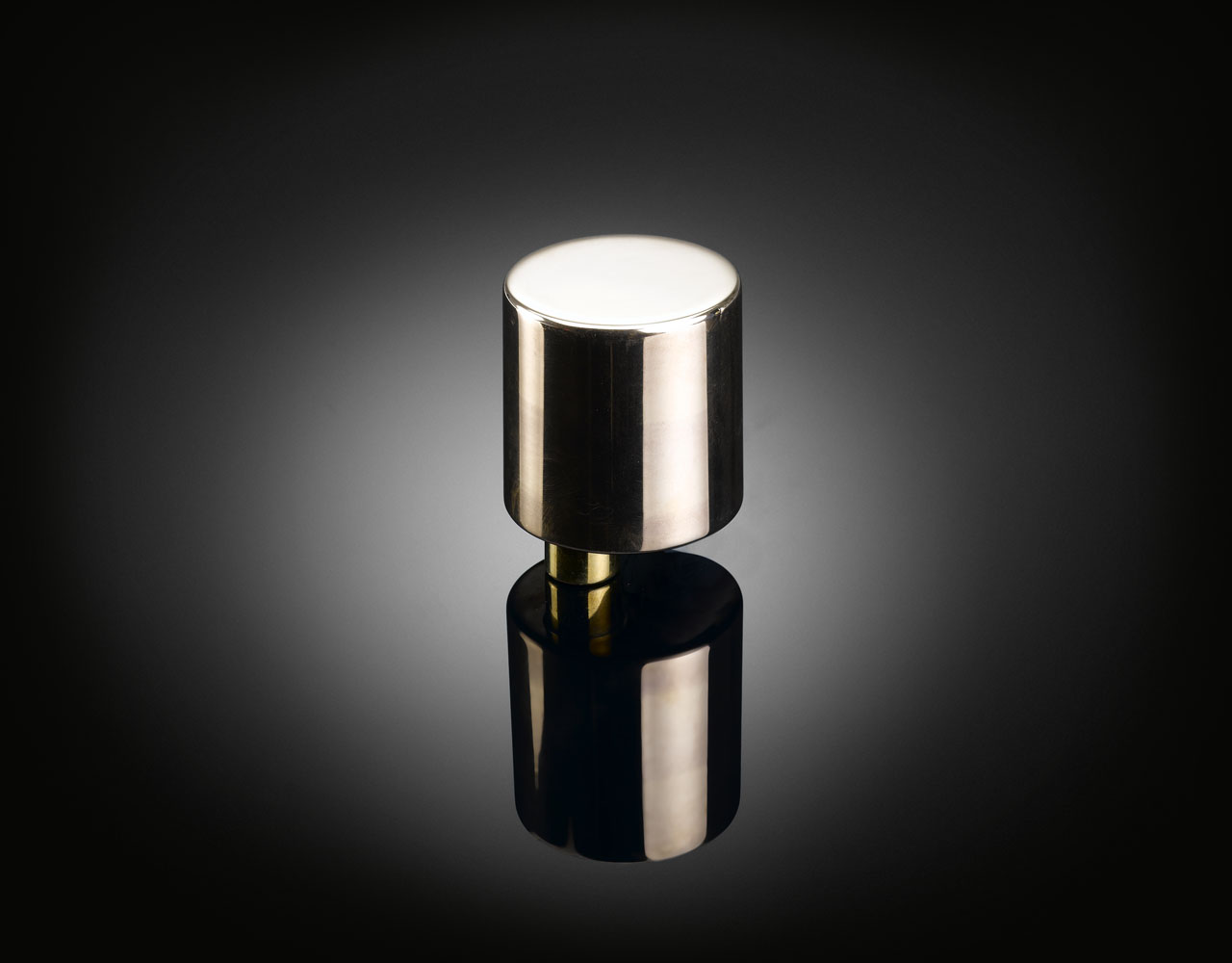 Bespoke eccentric polished brass door knob designed by Terrence Woodgate supplied by izé
