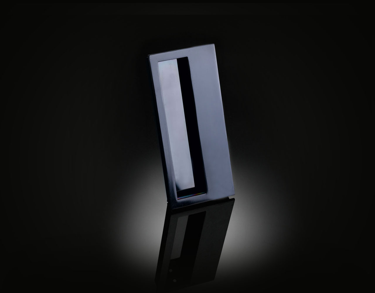 Minimalist flush pull handle designed by Vesna Aksentijevic in Dark Bronze finish from izé VAFP02