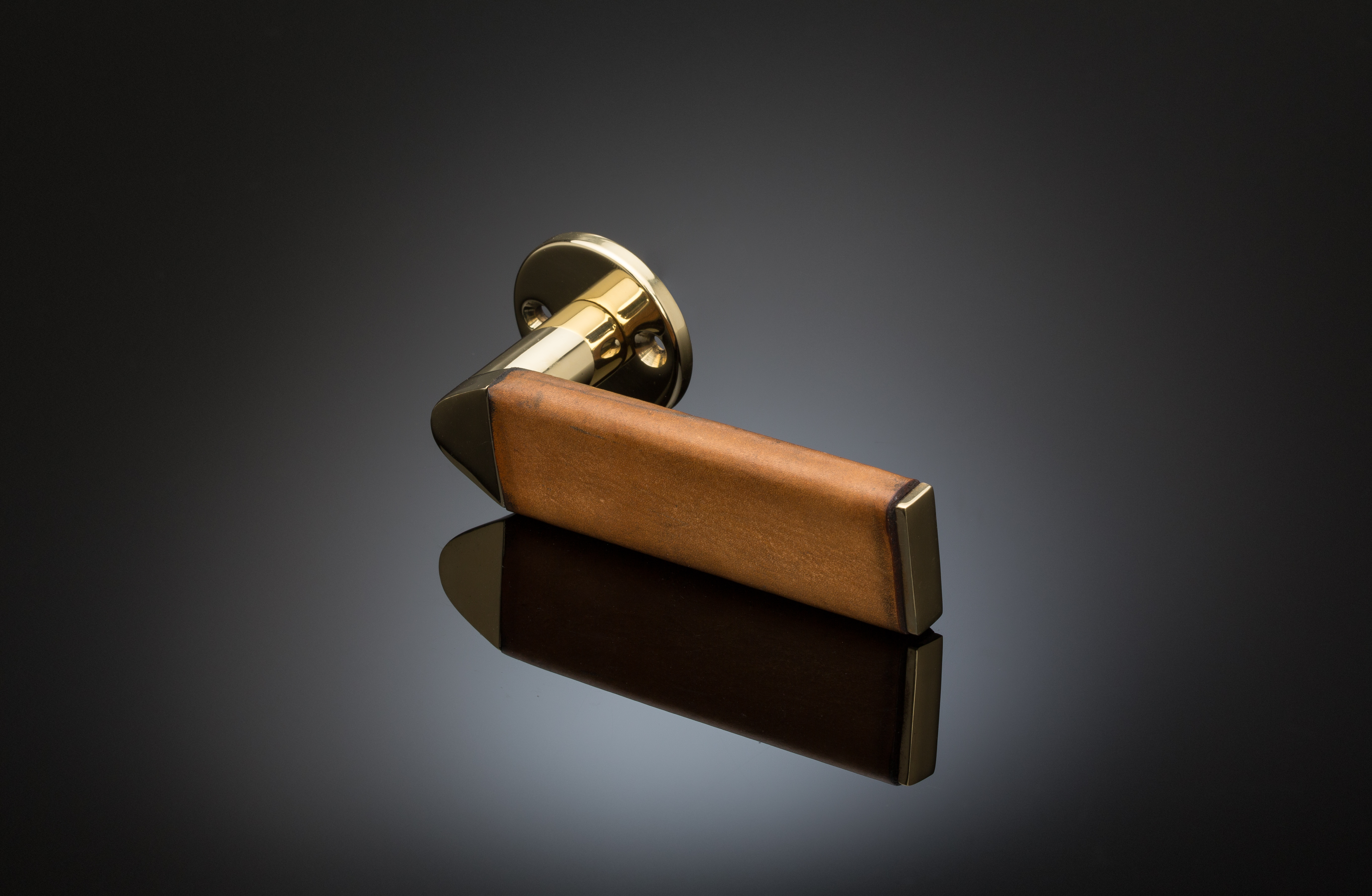 Leather covered lever handle designed by Juhani Pallasmaa, Finnish architect, leather and bronze material, Venice Biennale
