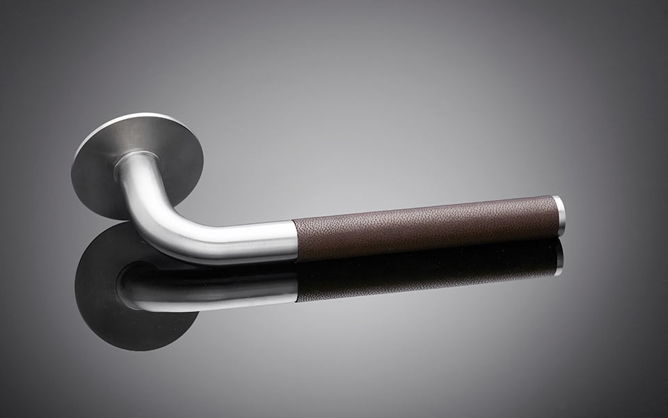 Lever handle with dark tan Morocco goat grip designed by Sergison Bates, architect designed, dark tan Morocco goat skin on door handle
