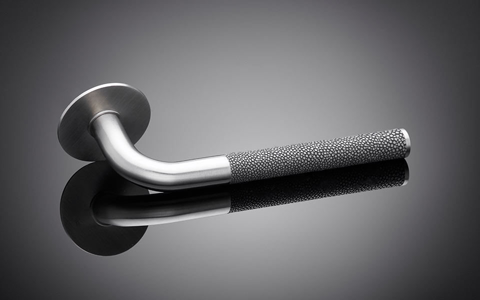 Lever handle with shagreen grip designed by Sergison Bates, architect designed, stingrays skin on door handle